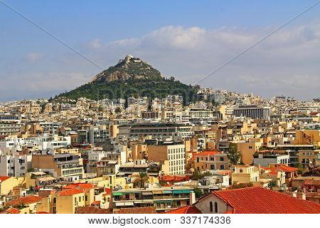 Colorful View Of Mount Lycabettus And The City Of Athens, Greece With Plenty Of Blue Sky Copy Space.