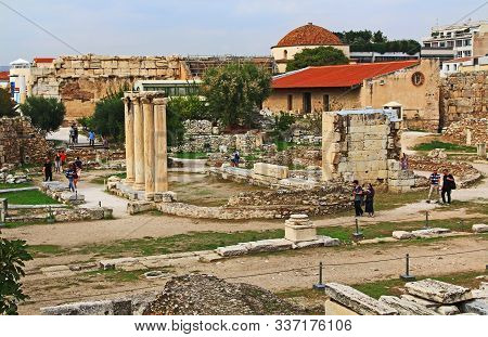 Athens, Attica, Greece - October 17, 2018:  Tourists Visiting The Site Of The Excavated Library Of H