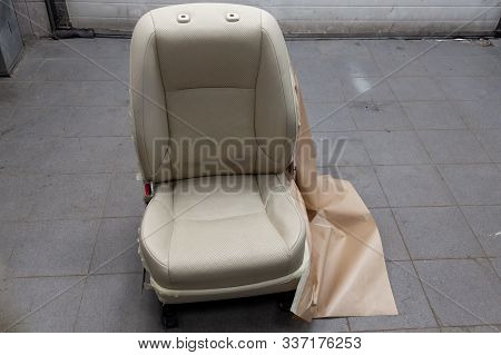 One Sport Seats With Beige Leather Trim, Located On The Floor In The Workshop For Repair And Tuning