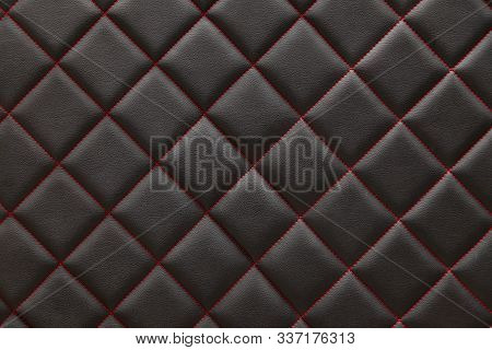 Black  Leather Background And Texture Stitched With Red Diamond-shaped Threads As A Pattern For The