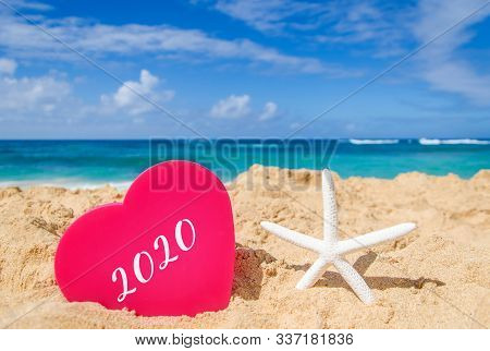 Symbol From Number 2020 On The Big Heart With Starfish On The Sandy Beach In Hawaii, Kauai