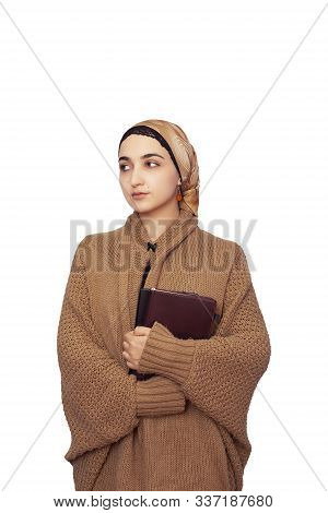 Stylish Muslim Woman In Warming Knitted Cardigan With Islamic Headscarf. Portrait Of Cute Middle-eas