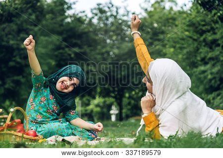 Portrait Of Happy Muslim Mother And Little Muslim Girls Child  With Hijab Dress Smiling And Enjoy Re
