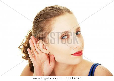 Surprised woman trying to listening a gossip , isolated on white background