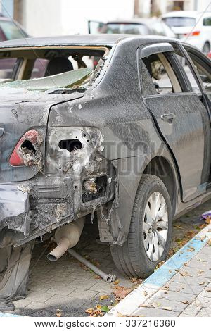 Burned Car, Burned-out Car Body. Road Wreck Accident Or Arson Fire Burnt Wheel Car Vehicle Junk