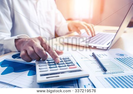 Businessman Analyze Data Of Stock Market Research.