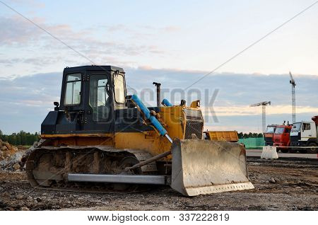 Track-type Bulldozer On Construction Site. Land Clearing, Grading, Pool Excavation, Utility Trenchin