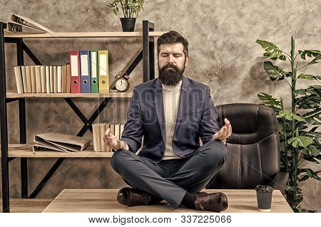 Prevent Professional Burnout. Man Bearded Manager Formal Suit Sit Lotus Pose Relaxing. Way To Relax.