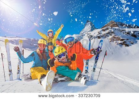 Happy family enjoying winter vacations in mountains. Playing with snow, Sun in high mountains. Winter holidays in Zermatt, Switzerland