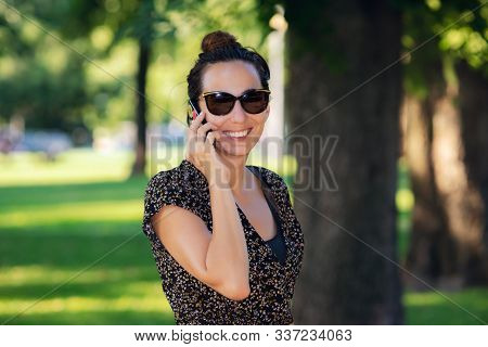 Woman Speaking On The Phone. Woman Speaking On The Cell Phone. Portrait Of Woman Speaking On The Cel