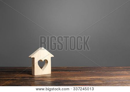 House With A Heart Window. Purchase Of First Real Estate For Young Families And Couples. Mortgage. A