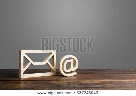 Email Symbol At Commercial And Envelope. Internet Correspondence. Contacts For Business. Internet An