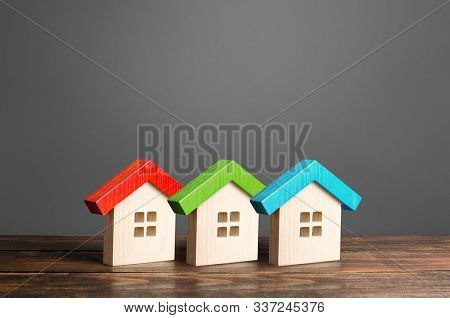 Multi-colored Wooden Houses. Affordable Comfortable Housing. Purchase Of Apartments And Real Estate,