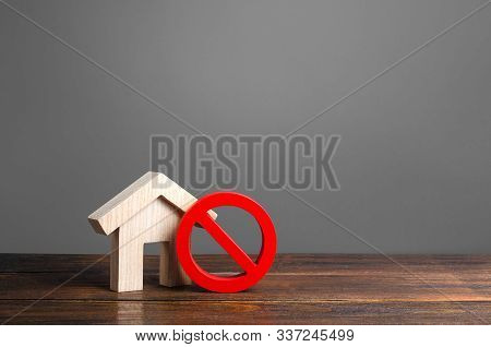House And Red Prohibition Sign No. Inaccessible And Expensive Housing. Seizure And Freezing Of Asset
