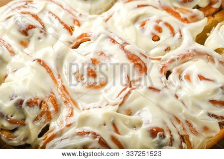 Fresh Homemade Cinnabons With Cinnamon And Cream Sauce On Parchment Top View Free Copy Space. Homema
