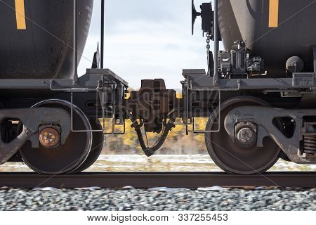 Closeup Of Couplers Between Two Tank Cars In Motion