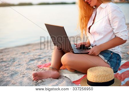 Isolated View Of Authentic Woman Working With Laptop On Sea Shore. Freelancer Girl Telecommuting Wit