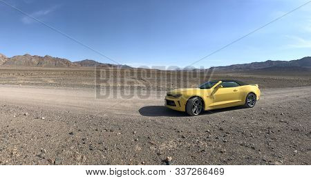 Death Valley National Park, Usa. Nov 2017: Yellow Chevrolet Camaro Convertible Parked Offroad