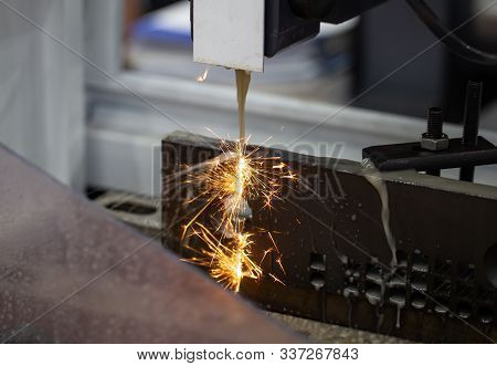 Electrical Discharge Machine Edm Cutting Workpiece With Flying Sparks In Workshop