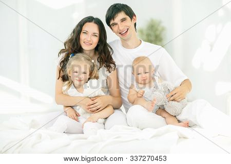 Background Image Of A Young Happy Family.