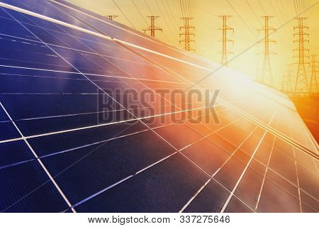 Alternative Energy For Energy Conservation Of The World (solar Panels With Power Plants In The Backg