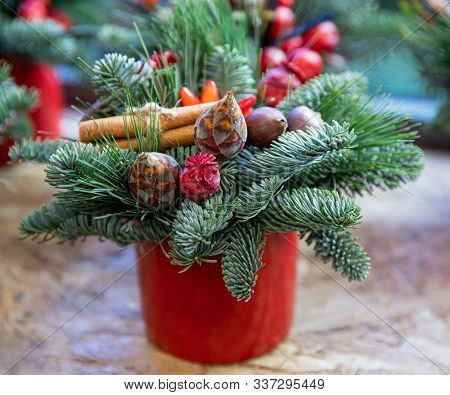 Winter Decor. Beautiful Arrangement From Natural Cones, Red Poppy Heads, Sprigs Of Pine And Spruce,