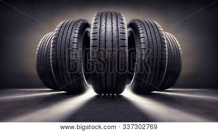 Close Up Of  Five Tires Against Black