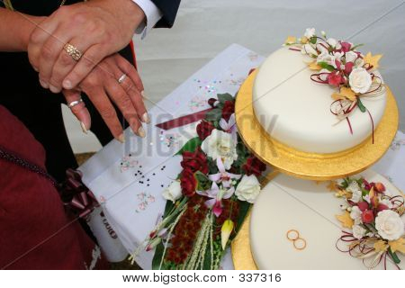 Wedding Rings, Cake And Flowers