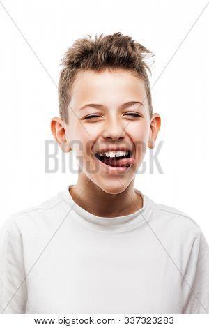 Funny toothy smiling handsome teenager boy looking face with open mouth and showing tongue white isolated