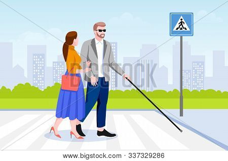 Young Woman Helps Blind Man With Stick Cross The Road. Taking Care Of Disability Handicapped People.