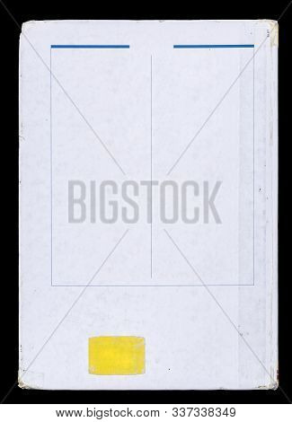 Back Cover Of A Book With A Yellow Blank Label, Isolated On A Black Background.