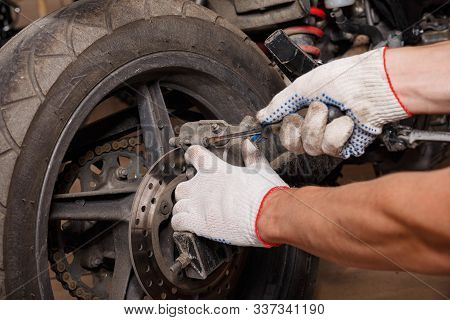 The Process Of Replacing Brake Pads On A Motorcycle.