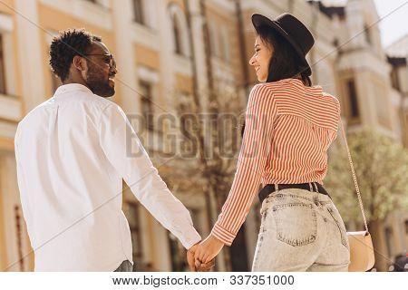 Mirthful Couple Enjoying Walking Outdoors Stock Photo