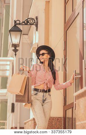 Smiling Woman Near The Shop Door Stock Photo