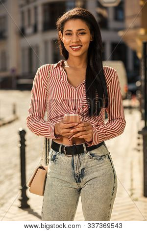 Mirthful Young Lady With Smartphone In Hands Smiling