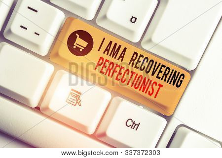 Text sign showing I Am A Recovering Perfectionist. Conceptual photo Obsessive compulsive disorder recovery White pc keyboard with empty note paper above white background key copy space. poster