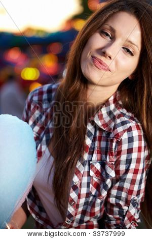 woman with candy floss in the lunapark