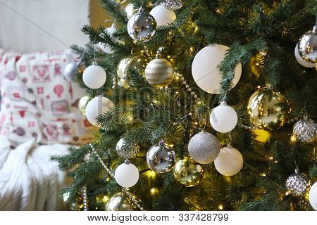 Decorated With Toy Christmas Tree And Pillow Close Up Photo