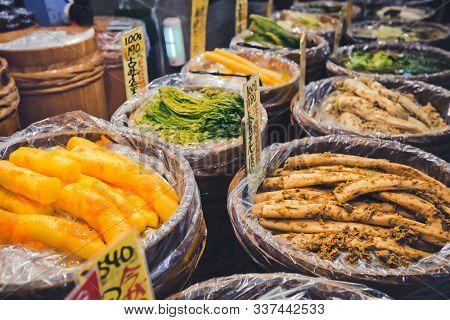 Kyoto, Japan - November 09, 2018: Various marinated vegetables at Nishiki market. Japanese preserved vegetable is a traditional dish for Japanese.