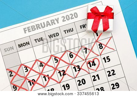 Calendar Page With A Red Heart On February 14 Valentine's Day And A Box With A Ring. The Calendar Sh
