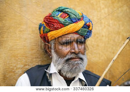 Jaisalmer, Rajasthan, India, November 2018 Local Artist In Traditional Costume Playing Traditional M