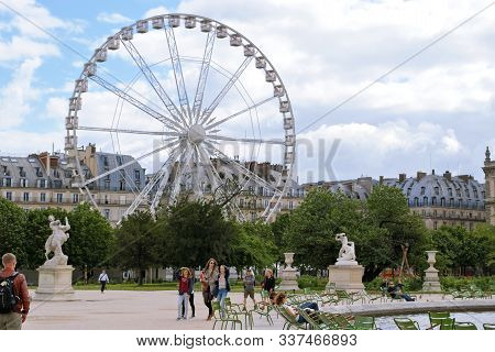 Paris, France, June 22: The Residents And Guests Of The City A Walk In The Park Of The Tuileries, Ju