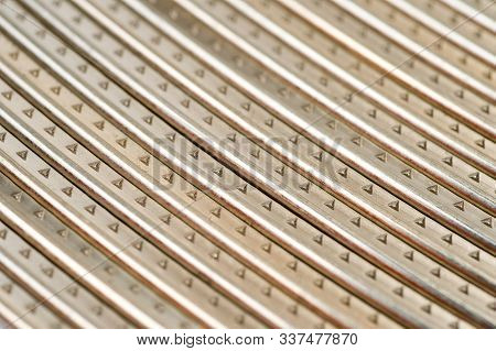 Frets Of The Guitar Neck Metal, Workpieces For Manufacturing, Shot Large On A White Background