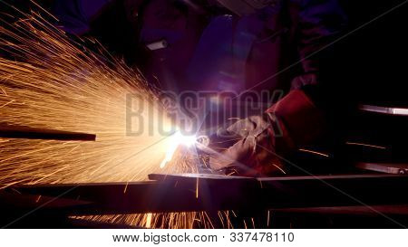 Worker In Gloves Cutting Sheet Metal In Fabrication Factory. Gas Metal Cutting With Acetylene Or Oxy