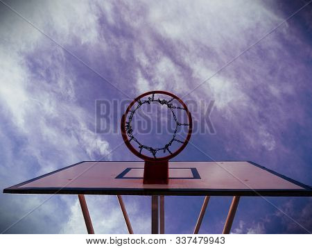 Basketball Rim, Basketball Net On A Basketball Court At A Basketball Game. The Background Is Clear B