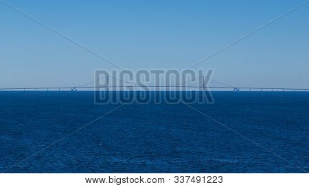Oresund Bridge With Cloudless Blue Sky And Ocean