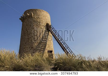 View Of A Tower From Carboneras, Almeria Distric, Old Fort Tower Sea And Mountain On The Coast Of Ca
