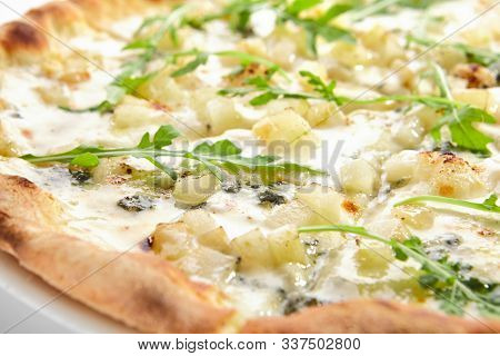 White four cheeses pizza with blue mold cheese, goat cheese, mozzarella and parmesan side view isolated. Traditional italian whole flatbread or ai quattro formaggi with fresh arugula