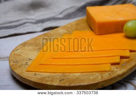 Cheese Collection, Block And Slices Of Yellow English Cheddar Cheese