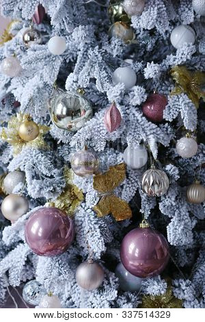 Close Up Photo Of Decorated Christmas Tree With Snow And Toys